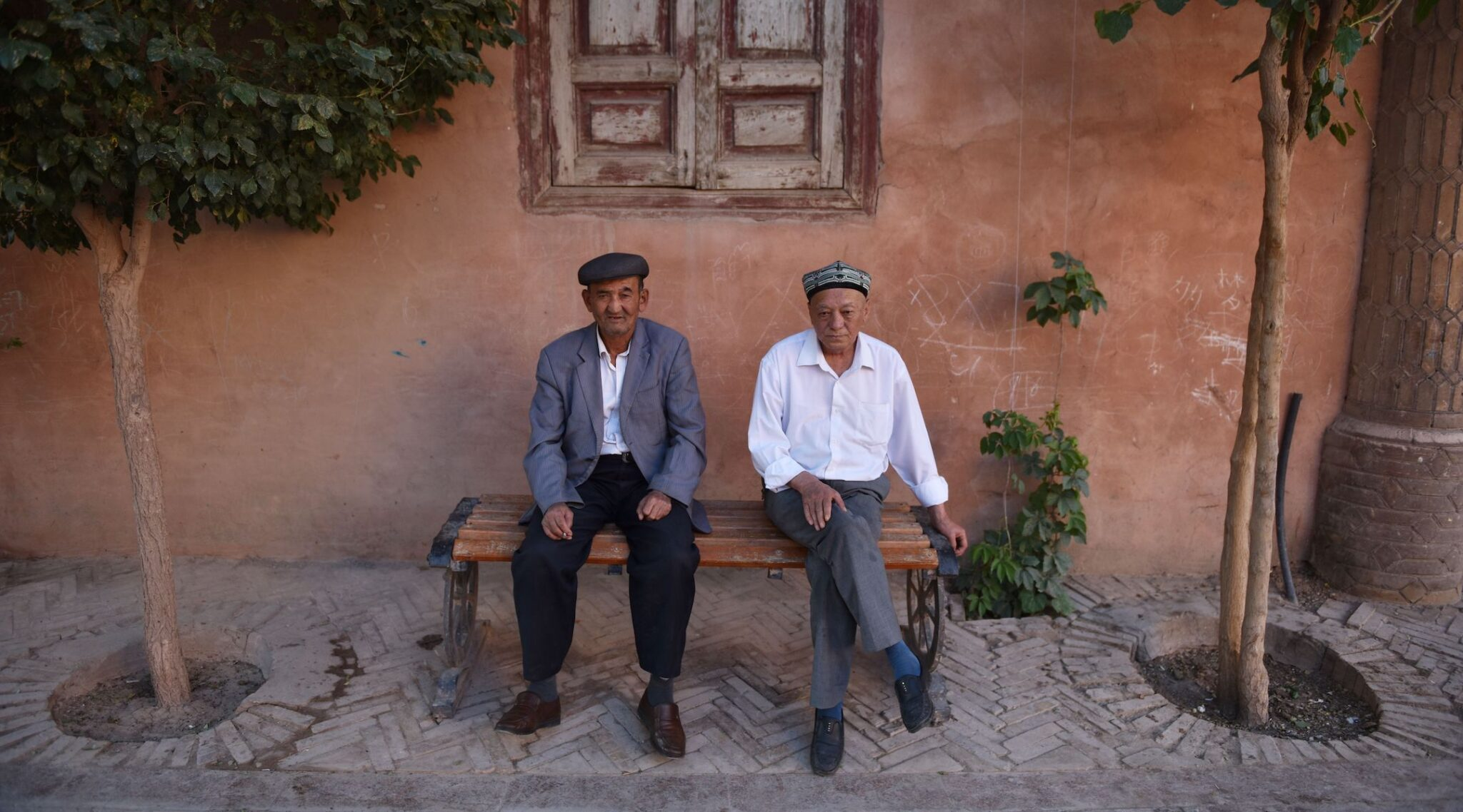 Uighur men rest in the restored old city area of Kashgar, in China's western Xinjiang region, in 2019. (Greg Baker/AFP via Getty Images)