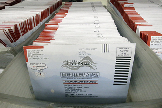 FILE - In this Nov. 1, 2016, file photo, mail-in ballots are shown at the elections ballot center at the Salt Lake County Government Center, in Salt Lake City (AP Photo/Rick Bowmer, File)