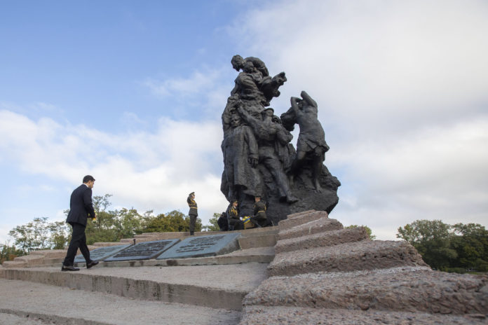 Ukrainian President Volodymyr Zelenskyy attends a ceremony at the monument to Jewish victims of Nazi massacres in Ukraine's capital Kyiv, Wednesday, Sept. 29, 2021. The ceremony commemorated the 80th anniversary of the Nazi massacre of Jews at the Babi Yar ravine, where at least 33,770 Jews were killed over a 48-hour period on Sept. 29, 1941. (Ukrainian Presidential Press Office via AP)