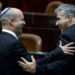 File photograph shows Israeli Finance Minister Yair Lapid (R) with Naftali Bennett, Economy Minister and Chairman of the right-wing Habayit Hayehudi (Jewish Home) party, as they confer on the floor of the Knesset (Parliament) in Jerusalem. EPA/JIM HOLLANDER